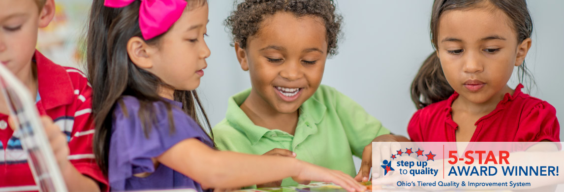 diverse group of preschoolers with puzzle